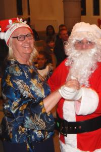 Lickey Concert and tree lighting 28 Santa and Janet dancing WEB 3-12-17