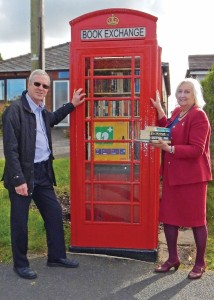 Defibrillator & book exchange launch Nick & Janet 8-10-15