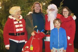 Santa with Jill, Lisa, sara and Max Lickey Tree lighting WEB 20181202 172403 2-12-18